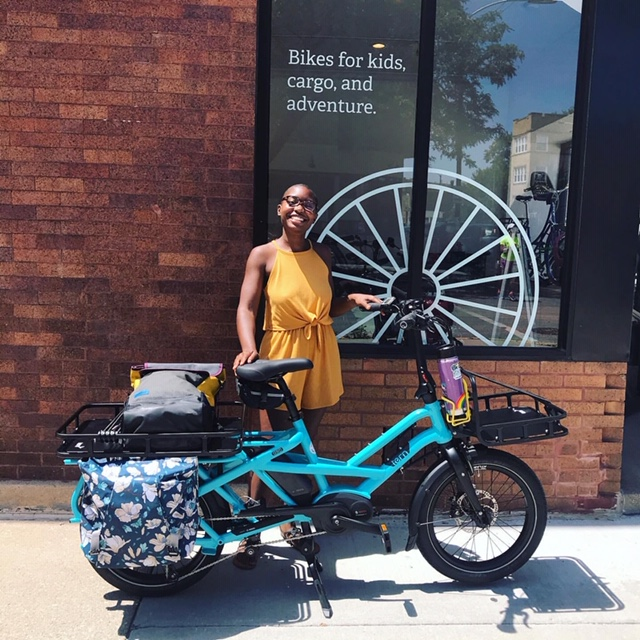 Courtney Cobbs with her new electric cargo bike at Cyclery.